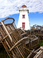 North Rustico Lighthouse and Old Lobster Traps, PEI, Canada